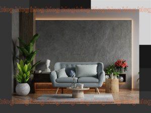 sala de estar com sofá cinza, plantas e led embutido na parede cinza