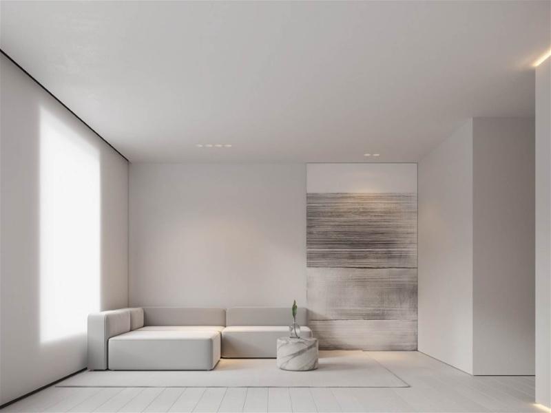 sala de estar ampla branca com sofá branco minimalista
