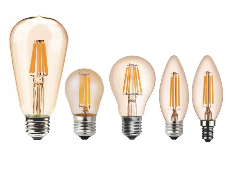 Imagem com fundo branco e diversa lâmpadas incandescentes uma ao lado da outra