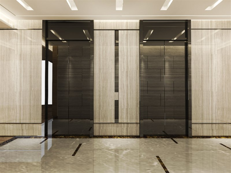 Hall de entrada com elevadores espelhados, local com bastante iluminação pisos e paredes claras