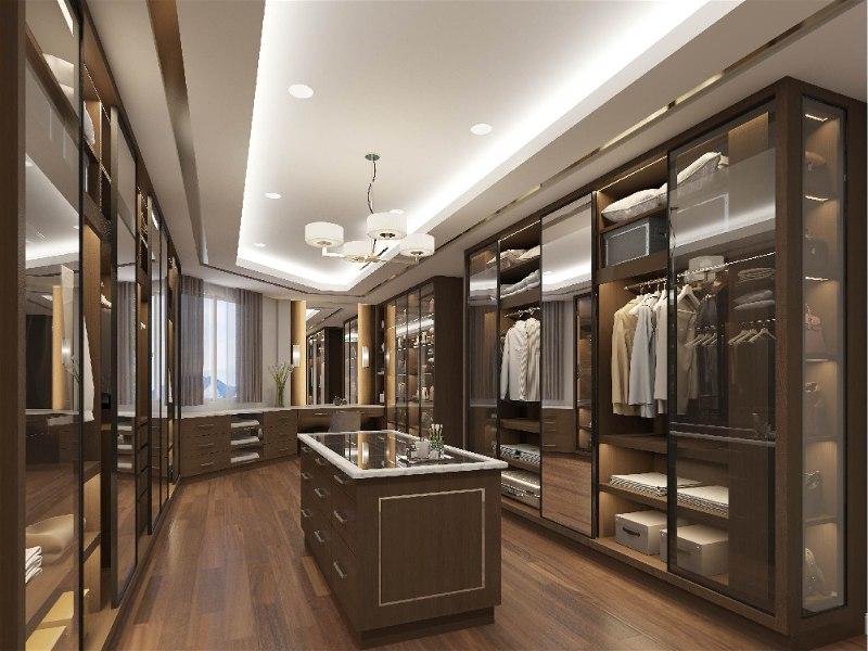 closet amplo com iluminação por lustre pequeno e spots