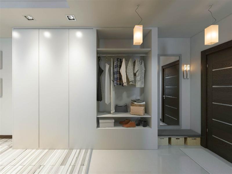 closet com pendentes e spots na iluminação