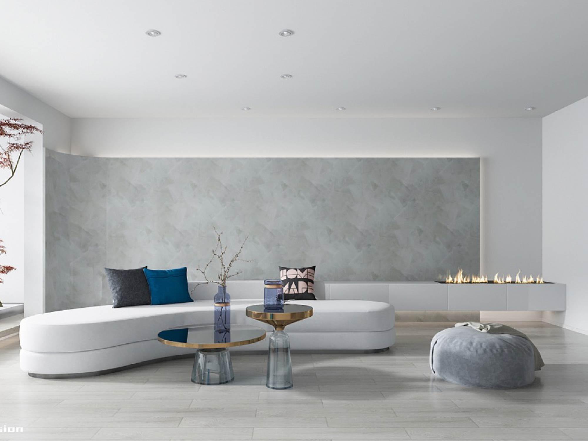 sala minimalista com parede texturizada em concreto e almofadas